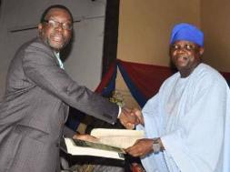 File photo shows Steve Ayorinde, Commissioner for Information and Strategy (left) and Akinwunmi Ambode, Governor of Lagos State