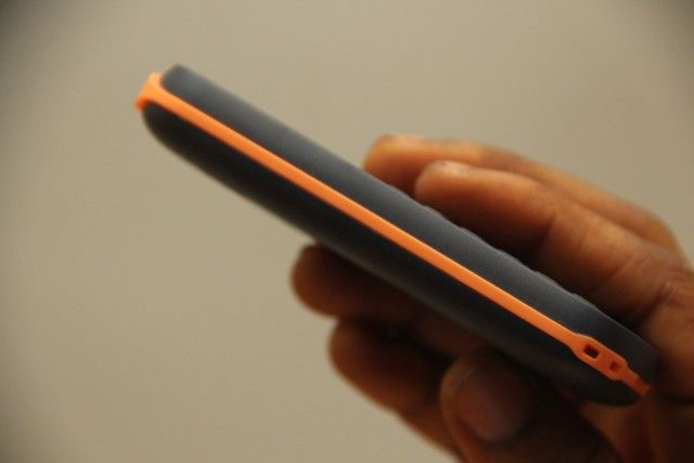 A mobile phone user hold the Nokia 103