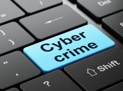 Security concept: Cyber Crime on computer keyboard background