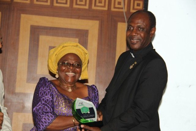 Mrs Mary Uduma, ex-President of NIRA (left) receives Special Recognition Award from Reverend Sunday Folayan, President of NIRA, at the event