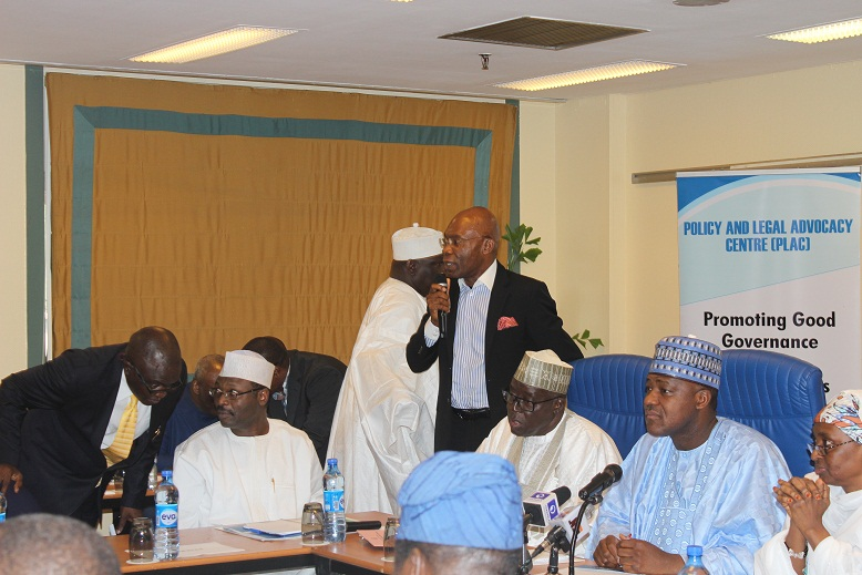 Dr. Leo Stan Ekeh, Chairman of Zinox Group, seen in photo standing, speaking Friday to lawmakers at the retreat organised by the House of Representatives Committee on Electoral and Political Parties Matter at the Transcorp Hilton, Abuja.
