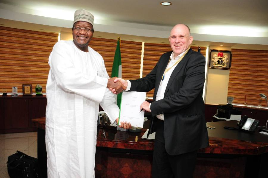 Executive Vice Chairman (EVC) of NCC, Professor Umar G. Danbatta, NCC (left) and Chief Executive Officer (CEO) of MTN, Fredinand (Fredi) Moolman, after the deal was signed