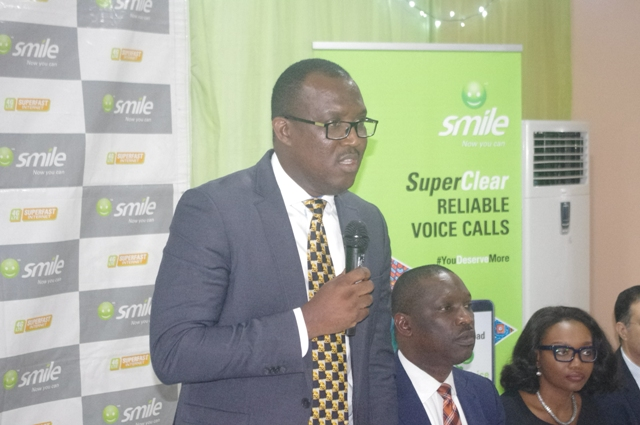 Mr Gode MD of Smile Communication delivering his speech at the event