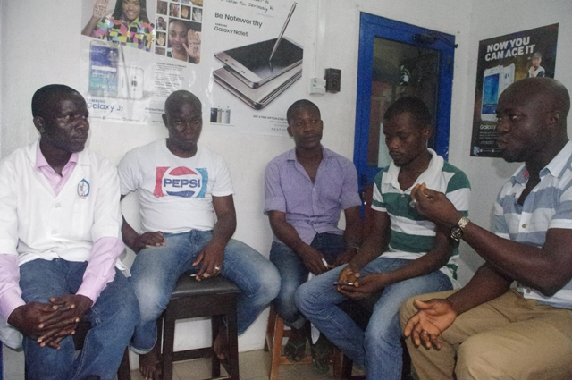 Mr Apara Kehinde Ige, National President of AMCODET (left) and executive team of the association representing the interest of mobile communication device technicians across Nigeria during an exclusive interview with Technology Times Ikeja Computer Village in Lagos