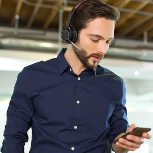 A man pictured using bluetooth headset