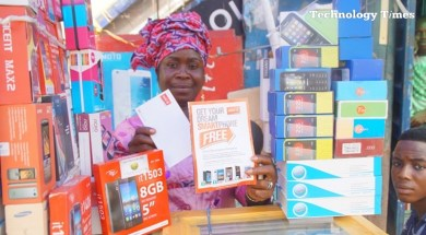 A mobile phone seller displays various models of mobile phones as Nigeria's mobile broadband market is projected to grow