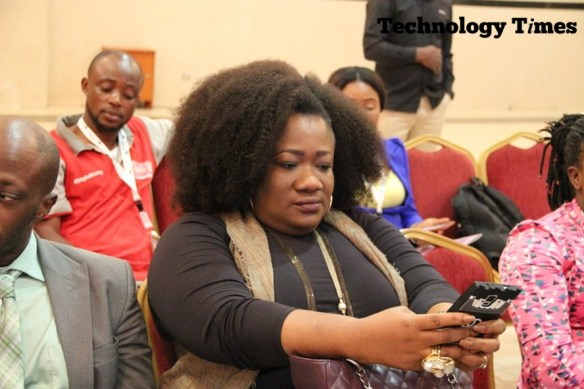 A lady seen looking at a smartphone the AWIEF 2016 event in Lagos