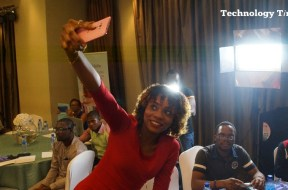 A lady seen taking selfie photograph at a mobile phone launch event in Lagos