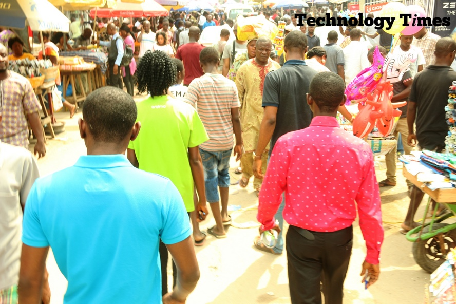 People seen walking through a street in Computer Village in Ikeja
