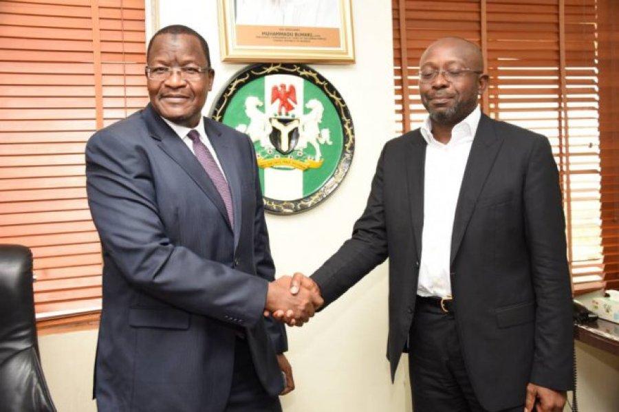 Professor Umar Danbatta, left, in handshake with Mr Boye Olusanya, Chief Executive Officer 9mobile formerly called Etisalat Nigeria