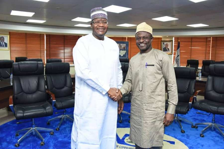 Professor Umar Garba Danbatta, Executive Vice Chairman and Chief Executive, NCC, left, in handshake with Bashir Ayodeji Idris, outgoing Head Legislative and Government Relations