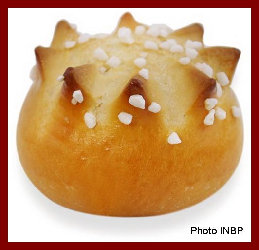 Une image contenant alimentation, beignet, donut Description générée avec un niveau de confiance très élevé