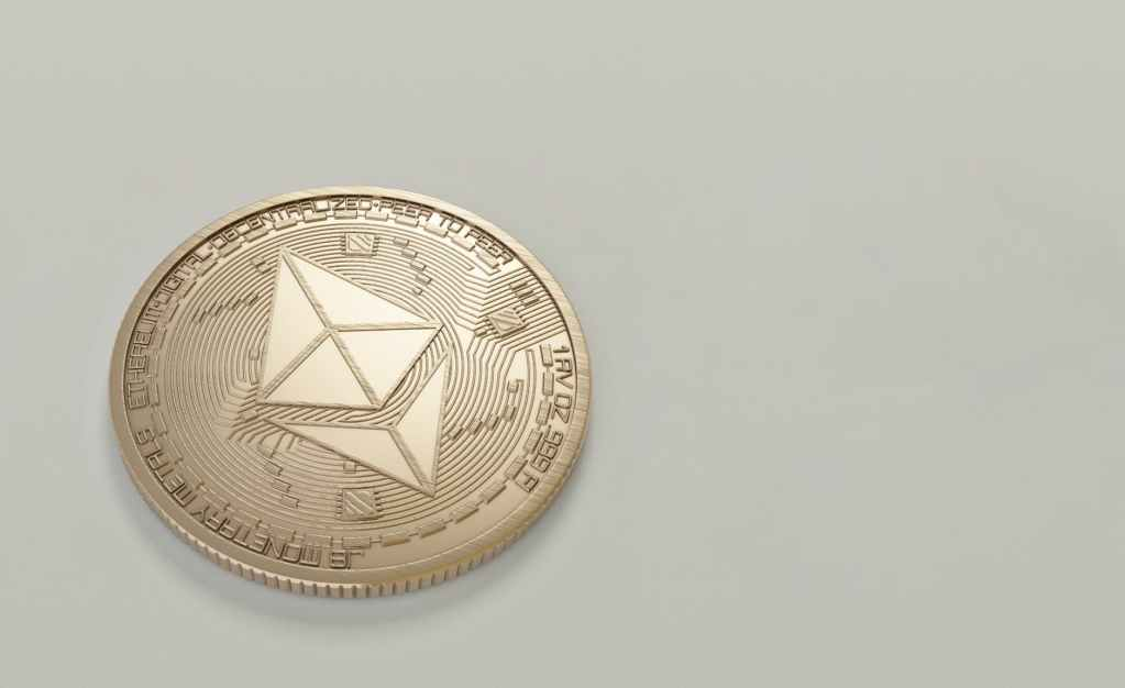 round gold colored ethereum coin