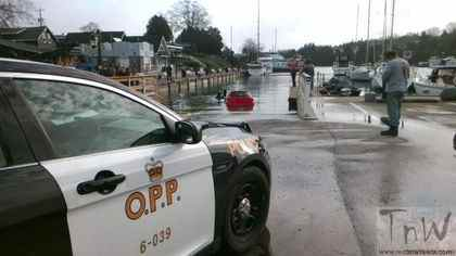 A car is towed from the harbour at Tobermory, Ont. (PHOTO: THE BRUCE PENINSULA OPP)
