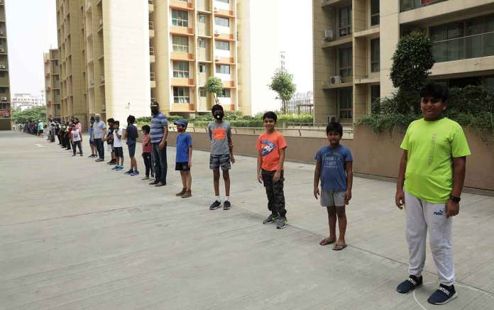 Citizens from Vasant Oasis specially kids and women marched in the morning carrying black flags to protest against builder's arbitrary parking policy