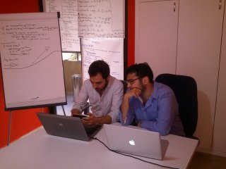 Co-founders Cedric Maalouf (l) and Rakan Nimer brainstorm in their co-working space, located in Soufi, Ashrafiyeh. (Photo by Osman Kudsi)
