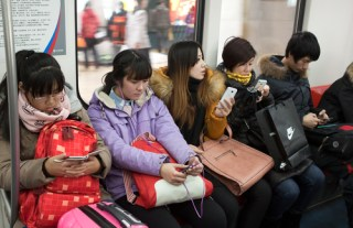 Mobile phone users in Beijing (image via Shutterstock)