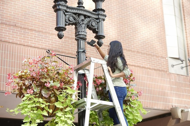 An MIT student installs sensors in Downtown Crossing, Boston, as part of an effort to generate data to help small businesses. (Photo courtesy GoDaddy.com)