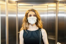 pandemic recovery - woman elevator