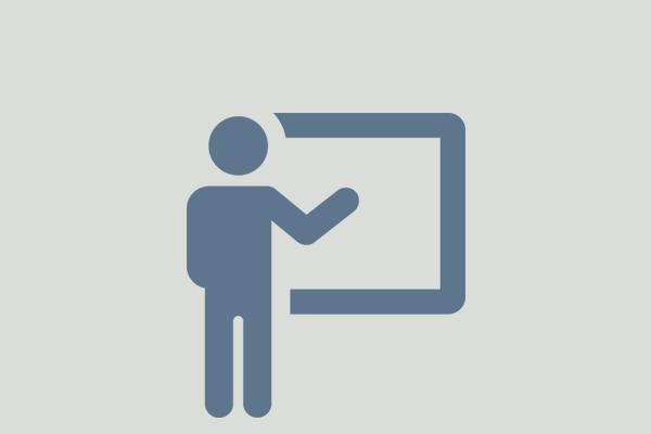 icon of a person standing in front of a white board