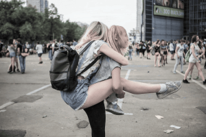 Girl carrying another girl on her back