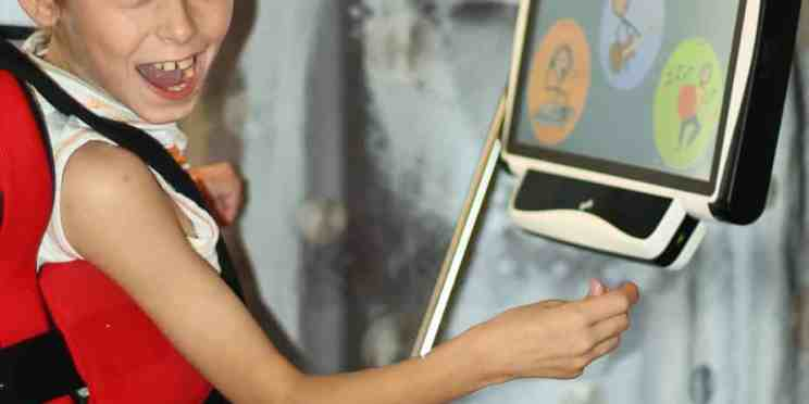 Child in a wheelchair using an eye gaze communication device
