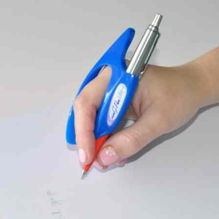 Hand holding a pen with the assistance of a blue contoured grip.