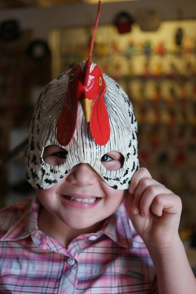 Emily in a Paper Mache Chicken Mask