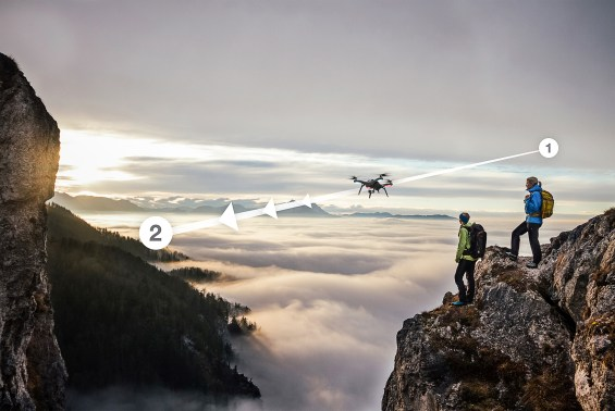 3D Robotics Drone: two female hiker above the sea of fog on top of a mountain at sunset