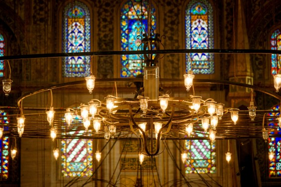 The light in the Blue Mosque used to come from candles but the electrical system still provides a nice glow for prayer. Istanbul, Turkey © 2015, Leticia Barr All Rights Reserved