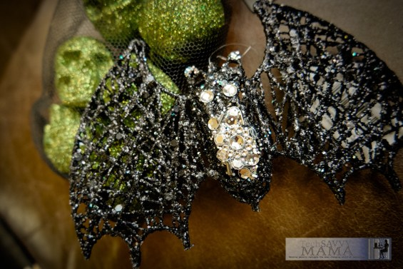 A bag of sparkly green skulls and a bejeweled bat © 2015, Leticia Barr All Rights Reserved