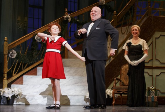Heidi Gray as Annie, Gilgamesh Taggett as Oliver Warbucks, and Chloe Tiso as Grace Farrell in Annie © Joan Marcus