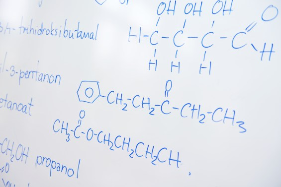 abstract science and chemical molecule structure on white board in school classroom background