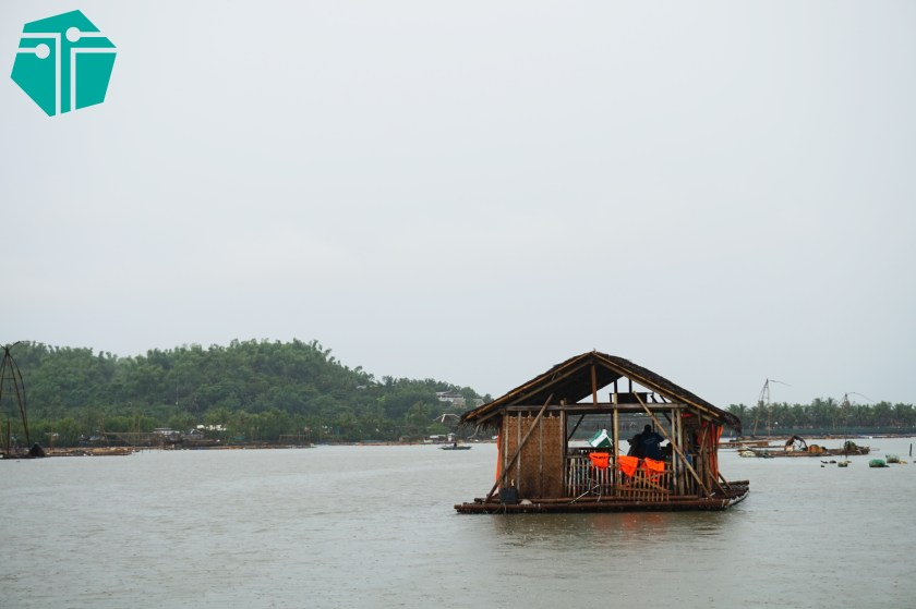 A photo of a bamboo raft with a hut afloat a rivier.  This Photo was taken during our Capture Capiz and Iloilo Tour.