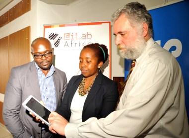 iLab Africa Executive Director Joseph Sevilla ( right) demonstrates app funtionalities to Samsung Electronics East (Source: Samsung  Kenya Blog)