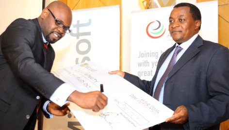 Signing the dummy cheque is Kunle Awosika, Country Manager Microsoft Kenya and holding on to the cheque is Victor Kyalo, CEO ICT Authority.