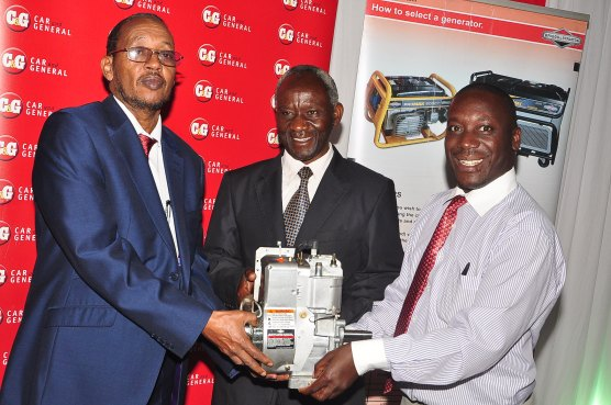 Bashir Mursal (L), Director of Technical Education Raphael Atanda(R), Car & General's Communications and Marketing Manager present an engine to Francis Saya (Center) the Principal, Sikri Institute for the Blind and Deaf during Car and General's annual Engine Donation Program.