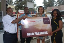 Gerald Matola (left), the Total Kenya Card Sales Manager and Cecilia Karanja (right), a Business Development Executive launched the partnership with Kagure Wamunyu (second right), the Uber Head of Operations Kenya and Fernandez Kariuki (second left), the Operation Cordinator.