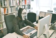 person wearing scream mask and-black hoodie