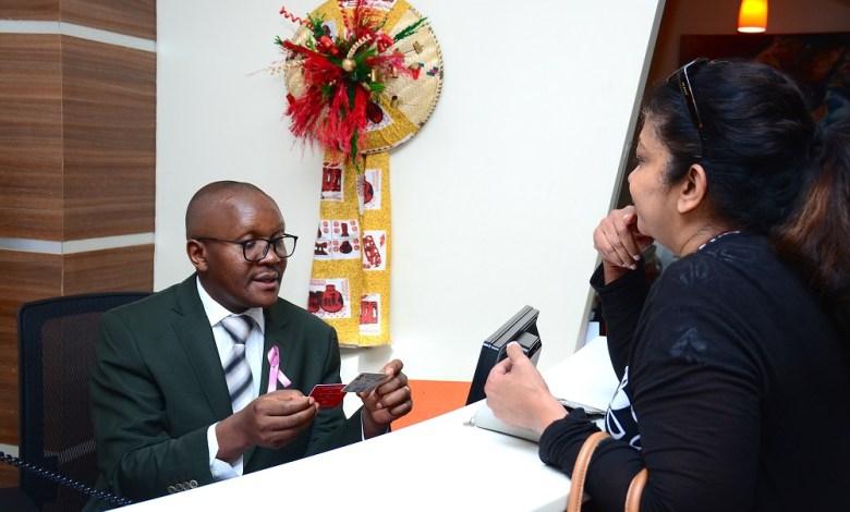 AAR Insurance Kenya Managing Director Nixon Shigoli attends to a customer as part of the company's customer service week celebration in 2019