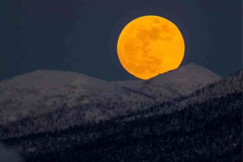 The moon seen over hills near the city of Yuzhno-Sakhalinsk on Sakhalin Island, Russia Photograph: Sergei Krasnoukhov/Tass