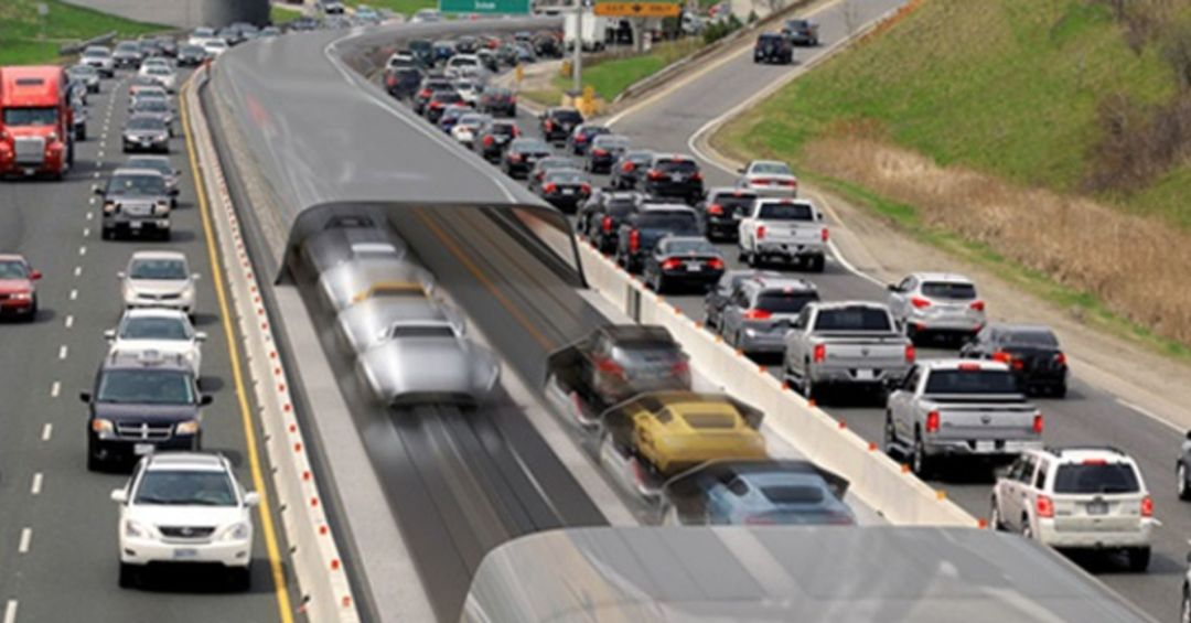 Cars zooming in the hyperloop lane, with traffic jams on normal highways on either side