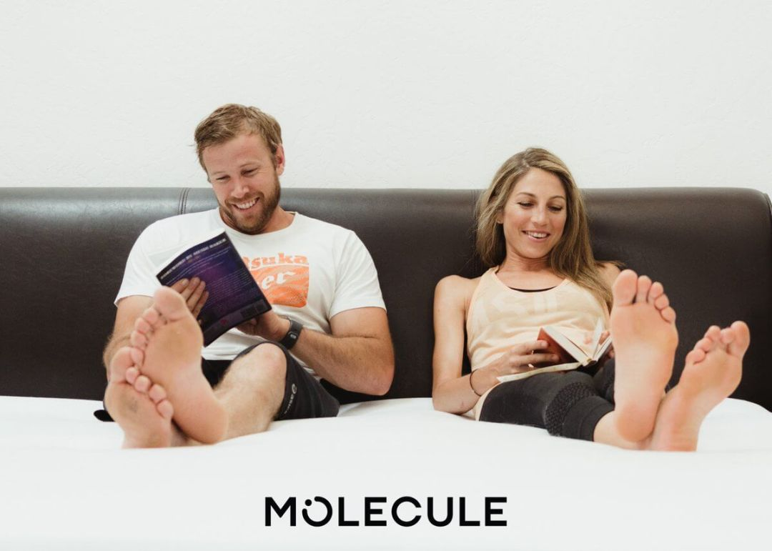 Relaxing on a bed in a box with Molecule branding