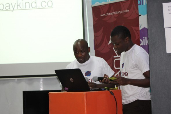 Paykind's co founders, CEO Rodgers Muhandi(left) and CTO Samuel Masinde doing a presentation during the launch of Paykind yesterday