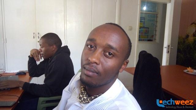 Eric Wainaina posing for the back 13MP back camera