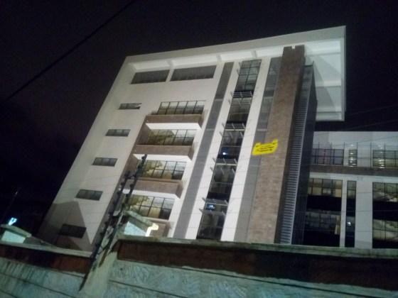 A nighttime shot of a lit building