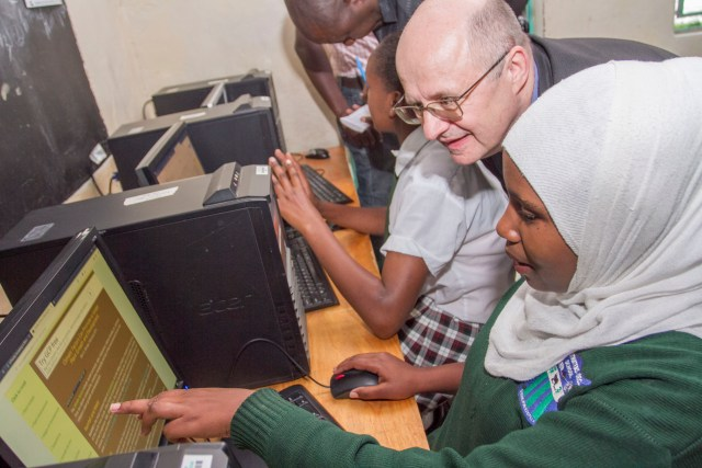 Microsoft 4Afrika Academy Dean Lutz Ziob with Dahabo Abdi a student at Sweetwaters Secondary during a familiarization trip of the Mawingu Project