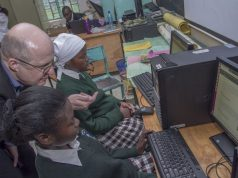 Microsoft 4afrika Academy Dean Lutz Ziob with students of Sweetwaters Secondary School