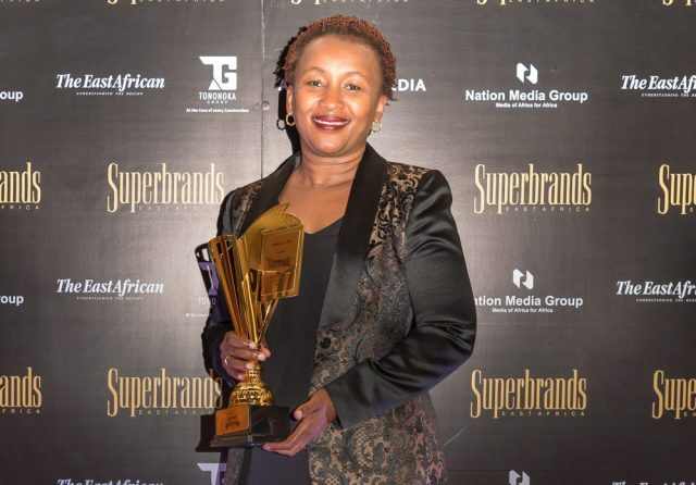Sylvia Mulinge, Chief Customer Officer, Safaricom, as she holds Safaricom award during Superbrands Tribute Awards 2018