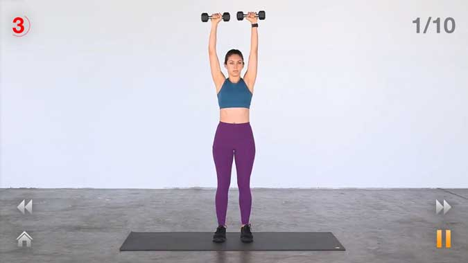 daily workouts- woman holding dumbells over her head
